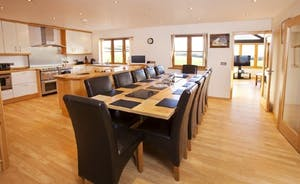 Large Dining Area Perfect for Family Gatherings or Celebrations with Friends