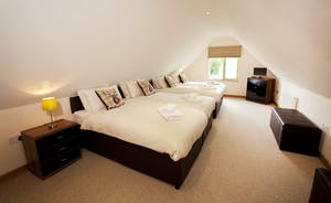 Crowcombe -  Bedroom 4 is a fantastic family room on the first floor, with an en suite shower room