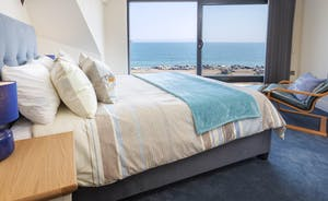 Master bedroom with king sized bed and sea views