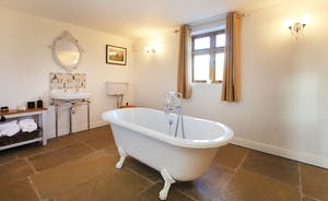 The ground floor bathroom has an elegant roll top bath