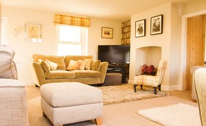 "Snuggle in to the sitting room with 42"" Smart TV, Sky Movies/Sports, deep pile rugs & large comfy sofas"