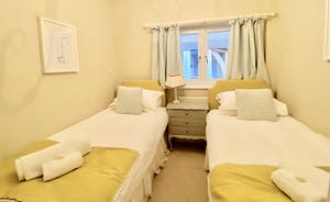 Twin bedroom with full sized single beds
