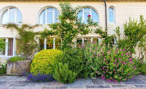 House On The Hill - The flower beds are a profusion of scent and colour