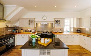 The kitchen with Rangemaster and Aga