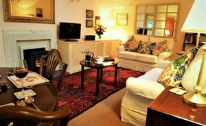 Coachmans Cottage, Steeple Ashton, Wiltshire, BA14 6HH. Easy to use log effect fire in the sitting room