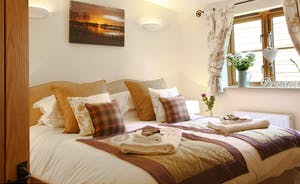 The beds all have sumptuous cushions and throws and we include towels, bathrobes and toiletries