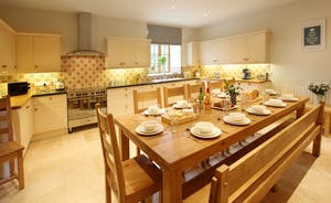 Huge, shaker kitchen with oak table seating 12 comfortably and all modern appliances