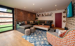 Pigertons - Soft seating to one end of the huge open plan living space