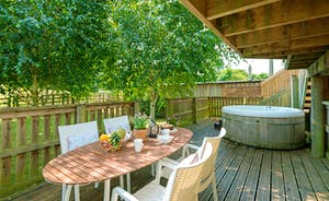 Outdoor table and chairs by the hot tub on decking perfect for the family