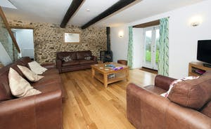 Whinchat Barns - Dippers Rest: A cosy living room; enjoy the warmth of the wood-burner on cold evenings