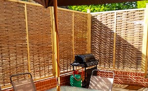Enclosed Courtyard with patio chairs and Gas BBQ