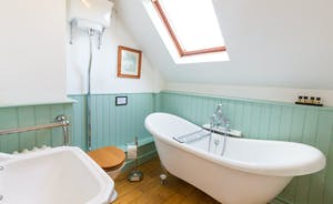 Frog Street: Bedroom 5, the Snug Room has a charming en suite bedroom with a free standing bath