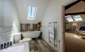 Croftview - Bedroom 12 (Blue Tit): The en suite has a free standing bath and a walk-in shower