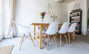 Comfortable Eames style chairs around the dining table