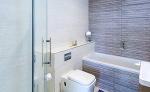 Bedroom 2 en suite with bath and separate shower