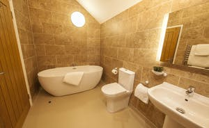 Beaverbrook 30 - Bedroom 1 en suite bathroom: to one end, a contemporary free standing bath