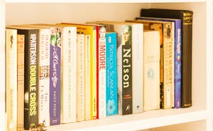Well stocked bookshelves on the landing