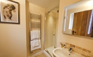Quantock Barns - The Wagon House: Bedroom 1 has a good sized en suite shower room as well as that lovely free standing bath