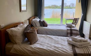 Goose Nest House Twin bedroom overlooking Somerford Lagoon