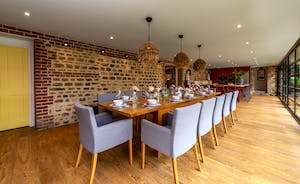Pigertons - A long dining table for happy holiday feasts - love those lampshades!