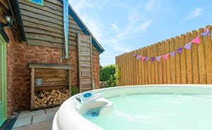 Enjoy a dip in the private hot tub on the patio