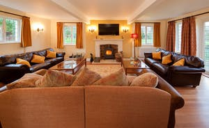 Ilbeare - A nice big living room - seating for all, a big TV, and a cosy woodburner should you need a bit of extra warmth