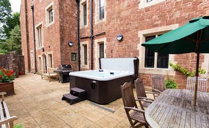 The Old Rectory - The private courtyard with hot tub, BBQ and outdoor furniture