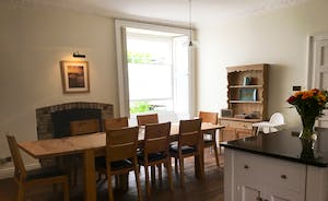 The kitchen offers plenty of space for informal dining