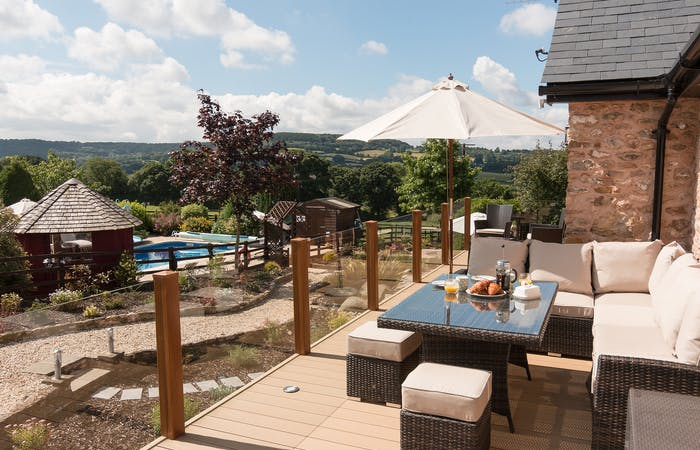 Holiday home with outdoor pool, hot tub and bbq lodge in Devon which sleeps 8 guests
