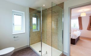 Orchard View - Bedroom 1: A roomy contemporary en suite shower room