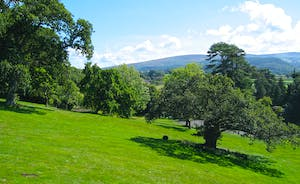 Bossington Hall - Softly rolling lawns and a vista of open hills and moors