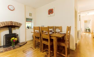 The Modern Shaker Style Kitchen / Dining Room has a Cosy Wood Burner