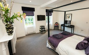 Pitmaston House - Bedroom 2 is a double room with a contemporary four poster bed, and an en suite bathroom with a separate shower