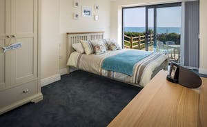 Bedroom 3 with access to garden and sea views