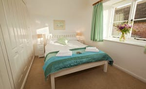 Halse Water House - Bedroom 3 has a double bed and shares the neighbouring bathroom with Bedroom 2.