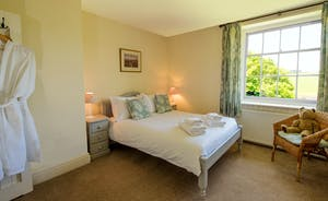 Pound Farm - Bedroom 5: With a view over the walled garden to the field beyond