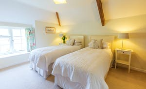 Frog Street - In the Orchard Suite Bedroom 2 has zip and link beds and is accessed via Bedroom 1