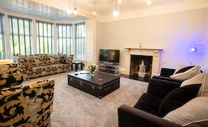 Sandfield House - The sitting room is sumptuous, light and airy