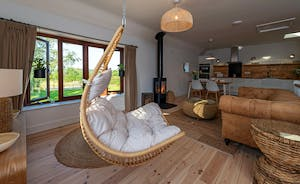 Whimbrels Barton - Curlews Halt: Upstairs the open plan living space has a wonderful hygge feel