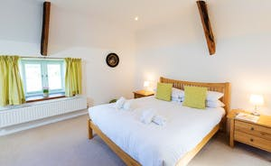 Dippers Rest, Stonehayes Farm - Bedroom 1 is on the first floor and has a kingsize pine bed