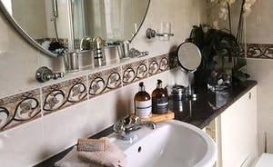 Lovely Light Airy Bathroom with fixed and portable mirrors flannels towels all provided swell as bath mats