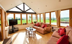 Wayside: The sun room is used as a second living room and has amazing views across the Culm Valley