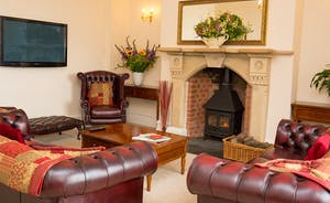 The Old Rectory - Relax in the sitting room / snug with a wood burning stove for those chillier days