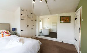 The Benches - Bedroom 2 has an open-plan en suite bathroom with a free standing bath.