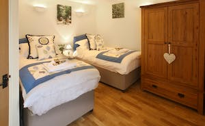 This bedroom is shown having twins beds- all beds can be six foot superkings or twins- so great flexibilty