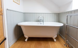 House On The Hill - An elegant roll top bath in the en-suite for Bedroom 6