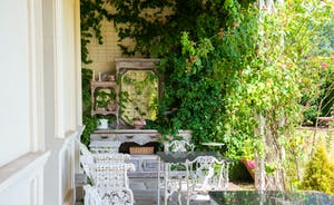 Severn Manor - Roses scramble over the veranda