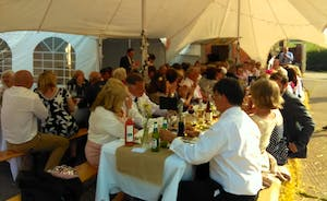 Marquee and long tables over the winery courtyard