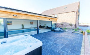 The Granary - The pool room opens out onto a sunny patio with a hot tub