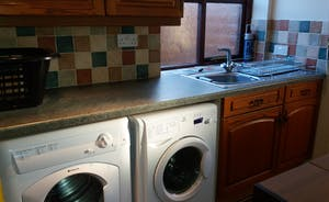 Utility room with washing machine, sink, tumble dryer etc